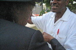 Willie Morgan greets an old friend in his Harlem garden.