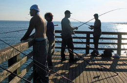 The serious fishers at the far end of the pier cordon themselves off so as not to be annoyed by amateurs.