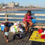 Yolene and her family spend the day on the pier, and sometimes much of the night too.